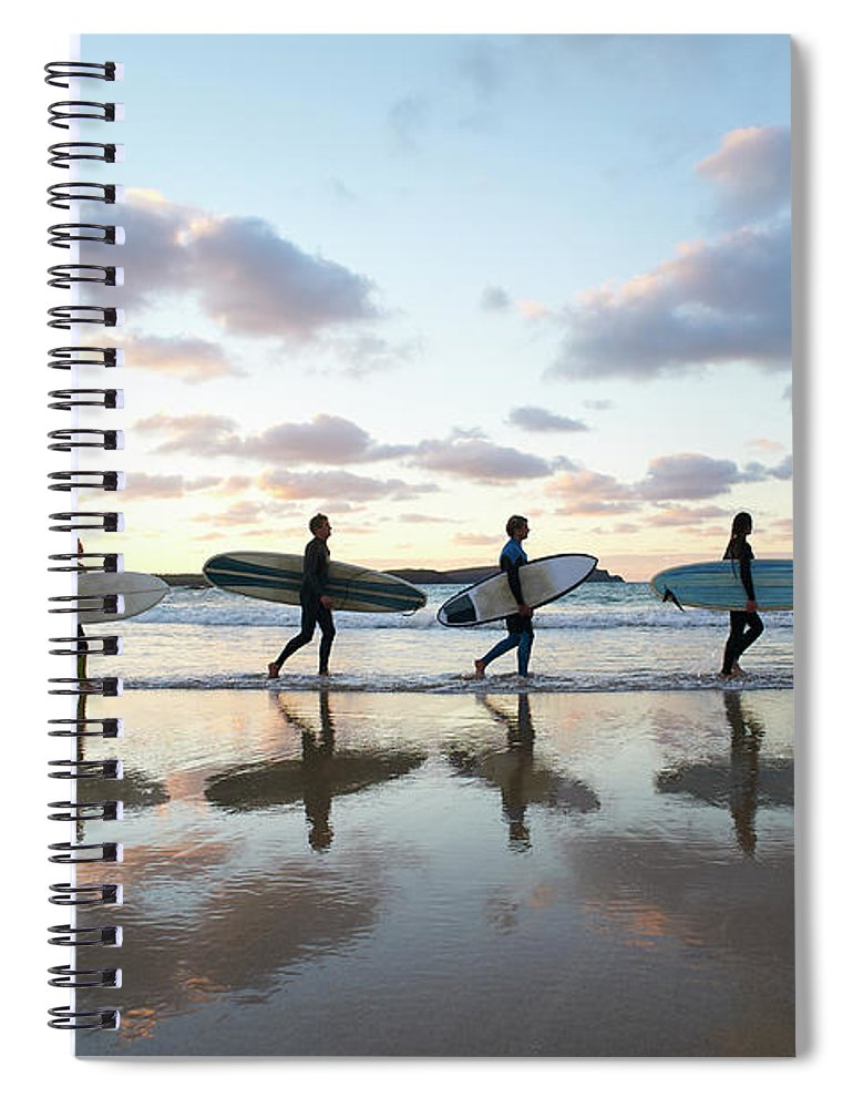 Young Men Spiral Notebook featuring the photograph Five Surfers Walk Along Beach With Surf by Dougal Waters