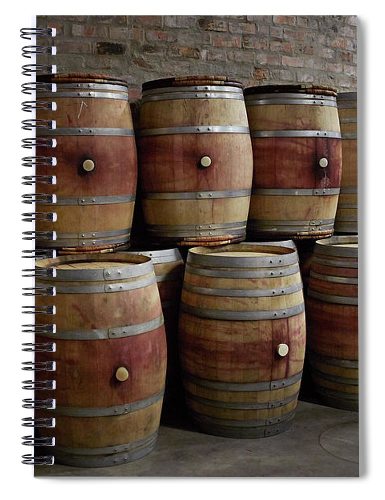 Stellenbosch Spiral Notebook featuring the photograph French Wine Barrels Stacked At Winery by Klaus Vedfelt