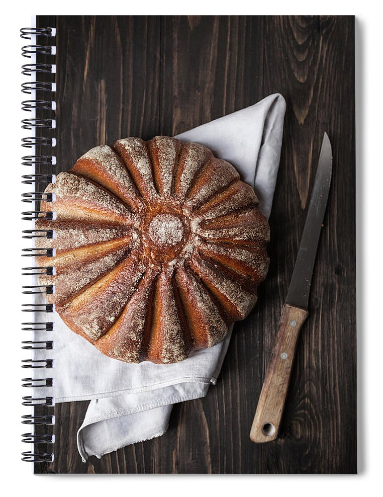 Kitchen Knife Spiral Notebook featuring the photograph Fresh Baked Bread With Kitchen Knife On by Westend61