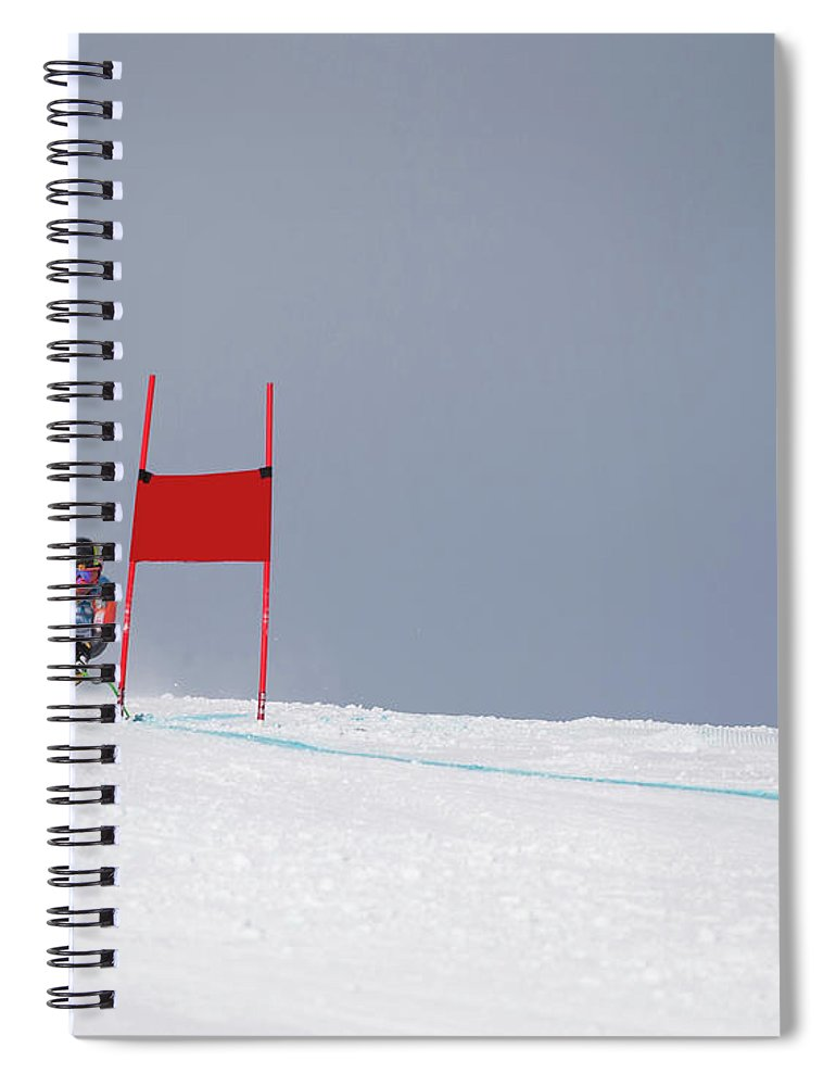 Skiing Spiral Notebook featuring the photograph Giant Slalom Skier Rounds Gate At High by Ascent Xmedia