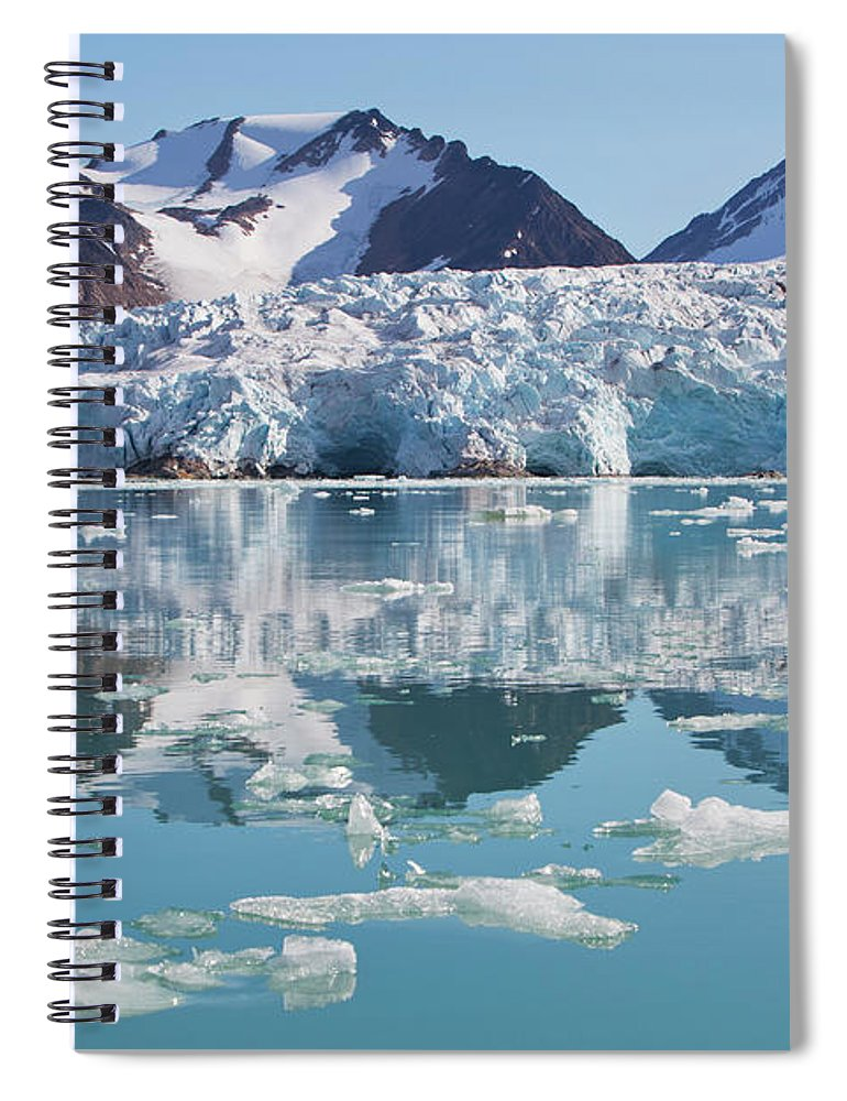 Scenics Spiral Notebook featuring the photograph Glaciers Tumble Into The Sea In The by Anna Henly