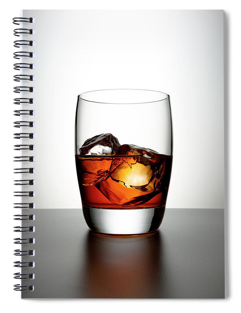 White Background Spiral Notebook featuring the photograph Glass With Brown Liquor And Ice Cubes by Chris Stein