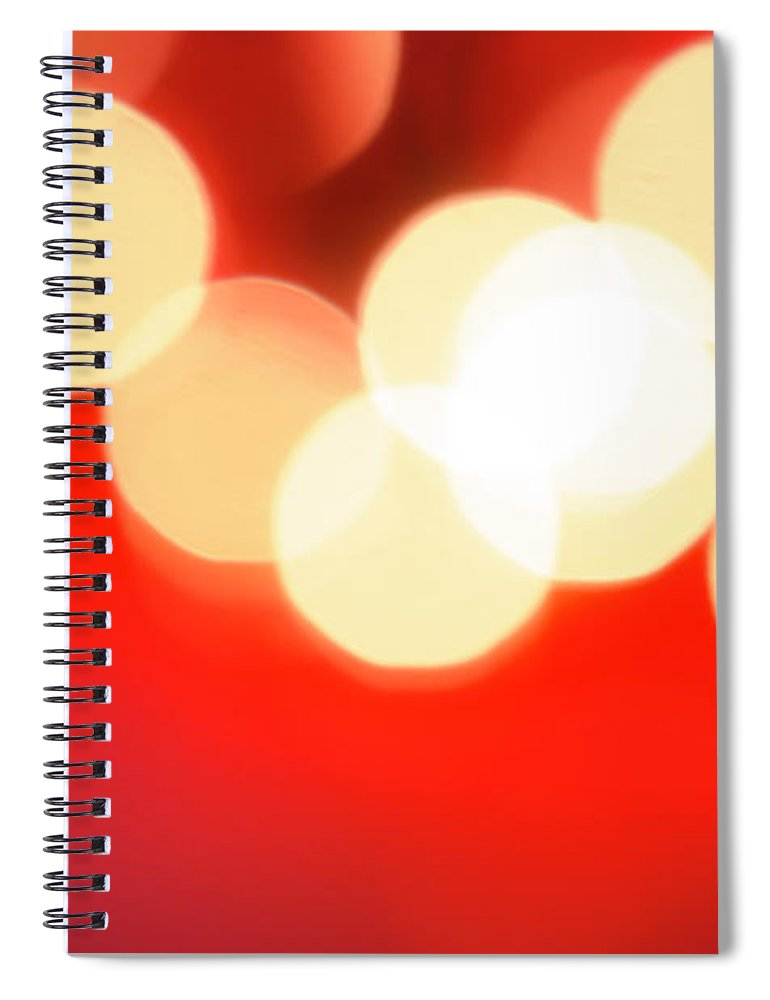 Christmas Lights Spiral Notebook featuring the photograph Glowing Light On Red Background, Studio by Tetra Images