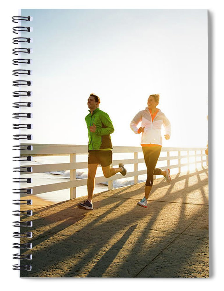 Young Men Spiral Notebook featuring the photograph Jogging Along The Coast by Jordan Siemens