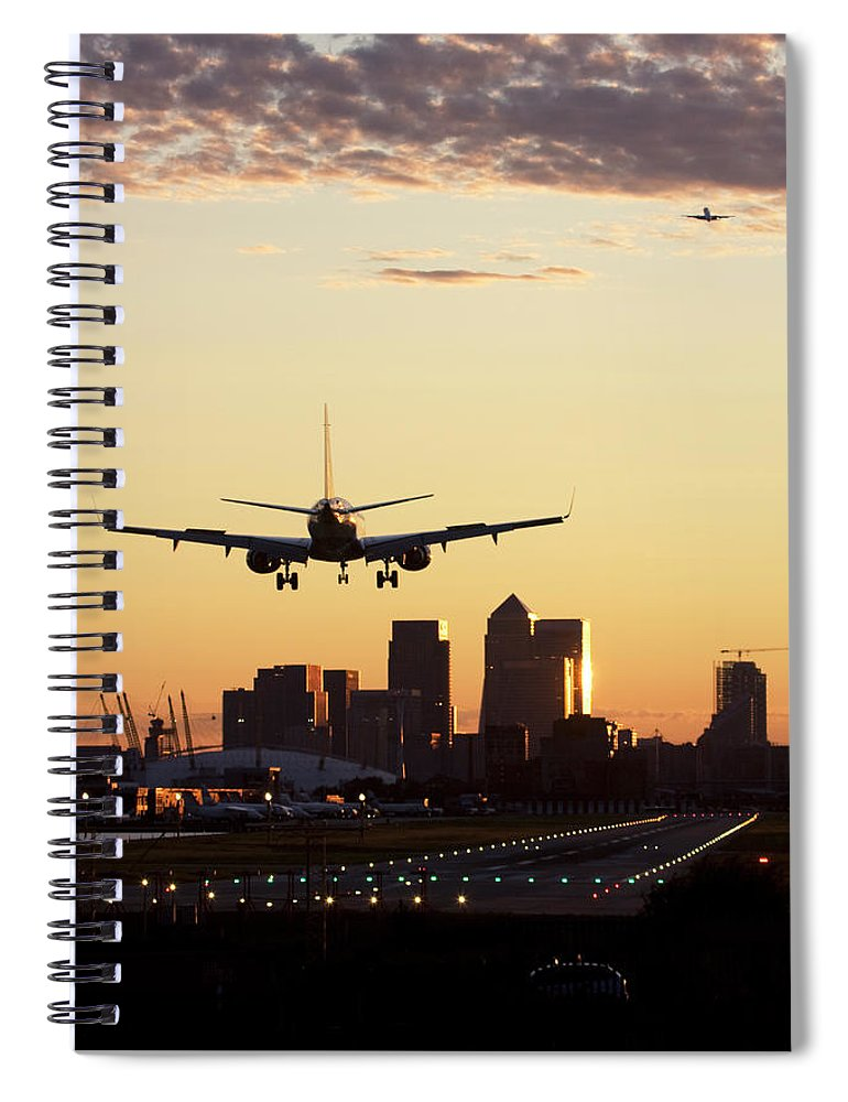 Taking Off Spiral Notebook featuring the photograph London City Airport by Greg Bajor