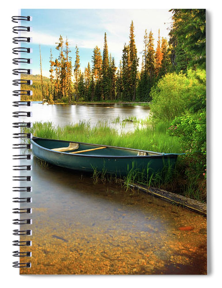 Tranquility Spiral Notebook featuring the photograph Lone Canoe On Shores Of Upper Payette by Anna Gorin