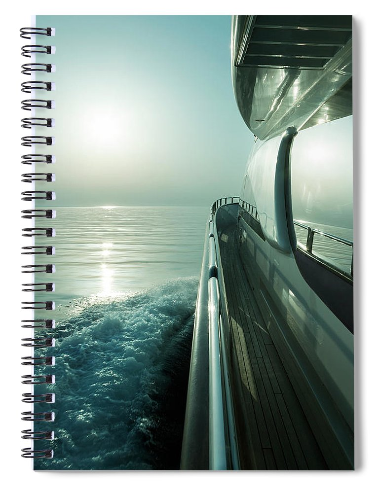 Desaturated Spiral Notebook featuring the photograph Luxury Motor Yacht Sailing At Sunset by Petreplesea