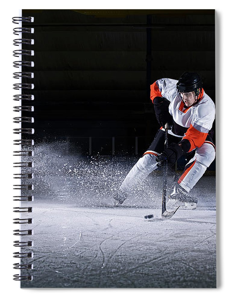 Focus Spiral Notebook featuring the photograph Male Ice Hockey Player Taking Puck by Mike Harrington