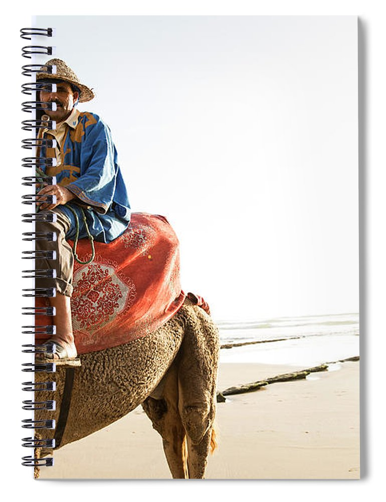 Agadir Spiral Notebook featuring the photograph Man On Camel On Beach, Taghazout by Tim E White