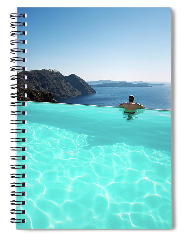 People Spiral Notebook featuring the photograph Man Relaxing Looking At Santorini by Peskymonkey