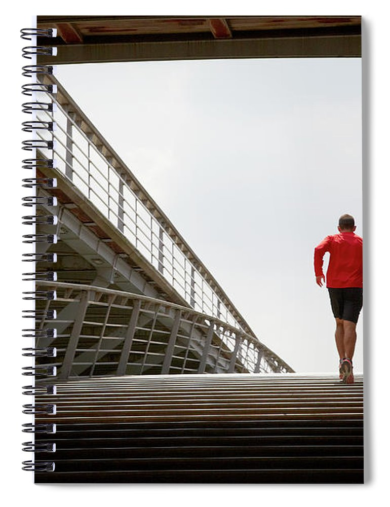 Steps Spiral Notebook featuring the photograph Man Running Up A Bridge by Chris Tobin