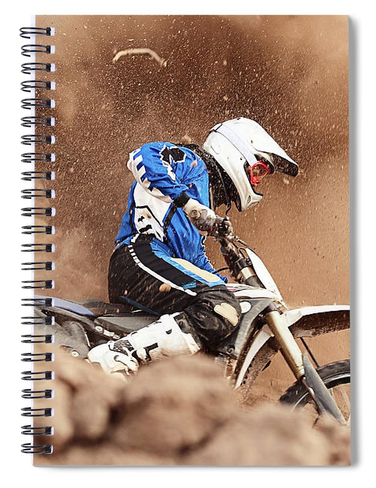 Crash Helmet Spiral Notebook featuring the photograph Motocross Biker Taking A Turn In The by Daniel Milchev