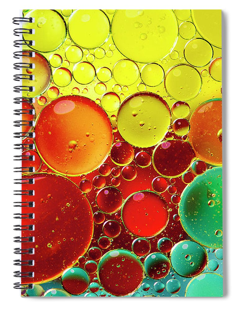 Full Frame Spiral Notebook featuring the photograph Oil Bubbles In Water by Ramoncovelo