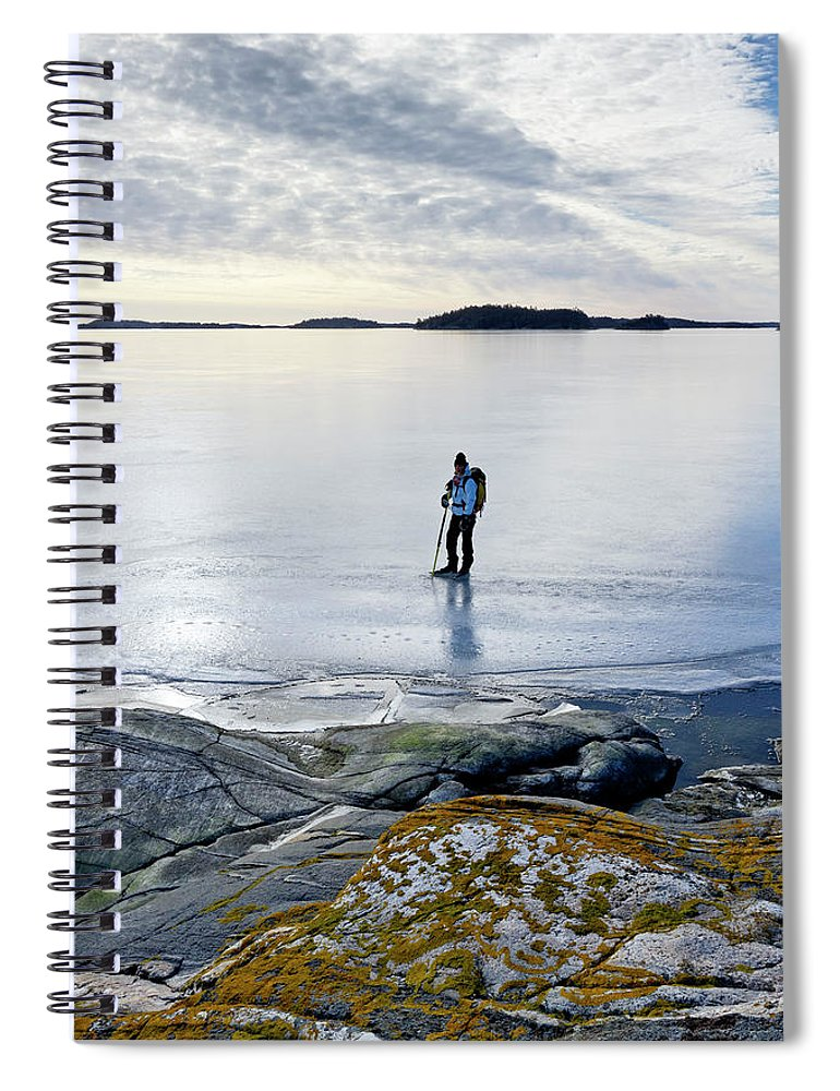 Archipelago Spiral Notebook featuring the photograph Person Skating At Frozen Sea by Johner Images