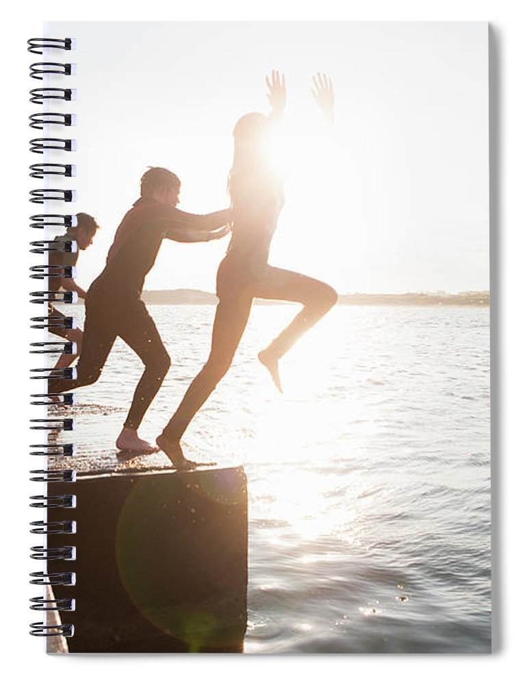 Adolescence Spiral Notebook featuring the photograph Pier Jumping by Solstock