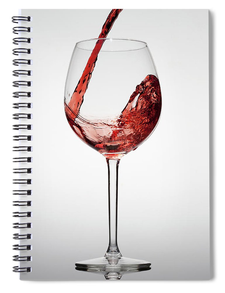 Alcohol Spiral Notebook featuring the photograph Red Wine Being Poured Into A Glass by Dual Dual