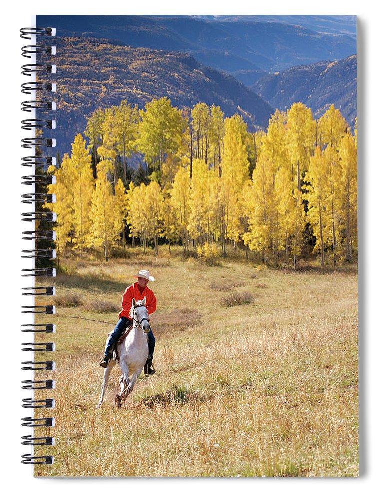 San Juan Mountains Spiral Notebook featuring the photograph Rocky Mountain Cowboy by Amygdala imagery