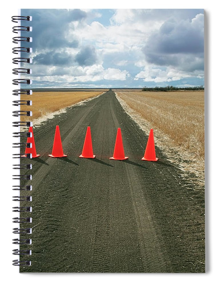 Orange Color Spiral Notebook featuring the photograph Safety Cones Lined Up Across A Rural by Benjamin Rondel / Design Pics