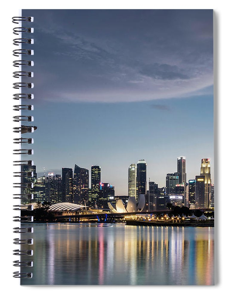 Built Structure Spiral Notebook featuring the photograph Singapore Skyline At Dusk by Martin Puddy