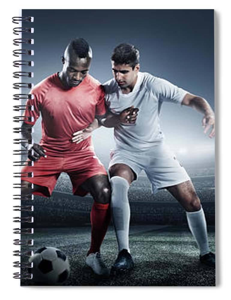 Soccer Uniform Spiral Notebook featuring the photograph Soccer Player Kicking Ball In Stadium by Dmytro Aksonov