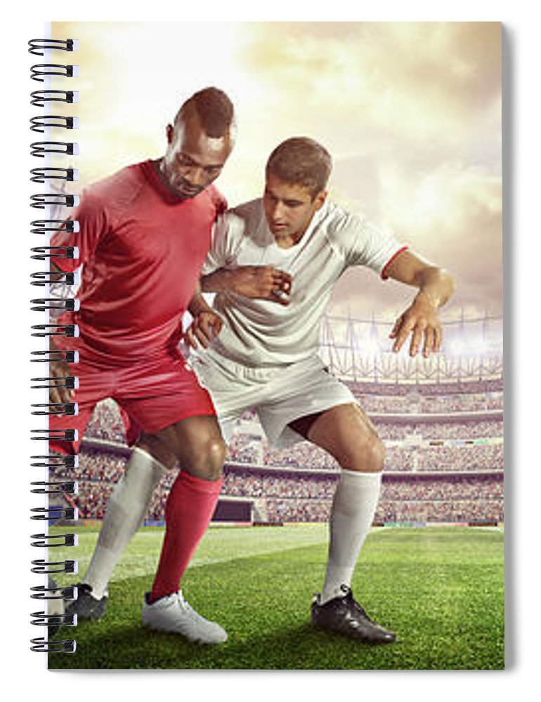 Soccer Uniform Spiral Notebook featuring the photograph Soccer Player Tackling Ball In Stadium by Dmytro Aksonov