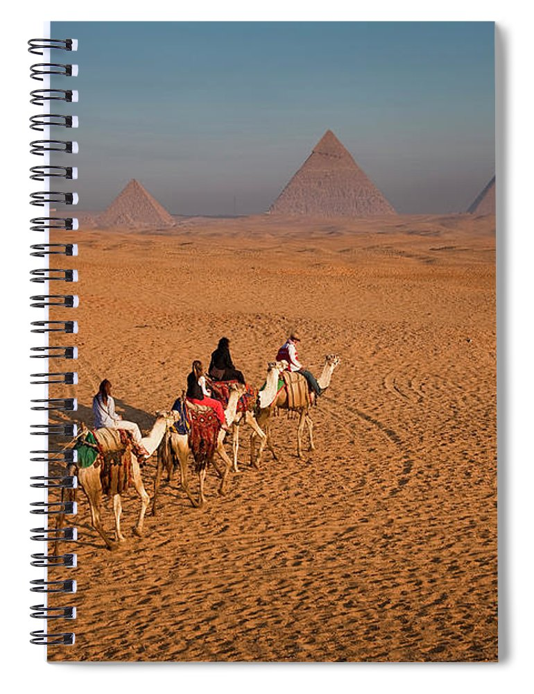 Working Animal Spiral Notebook featuring the photograph Tourists On Camels & Pyramids Of Giza by Richard I'anson