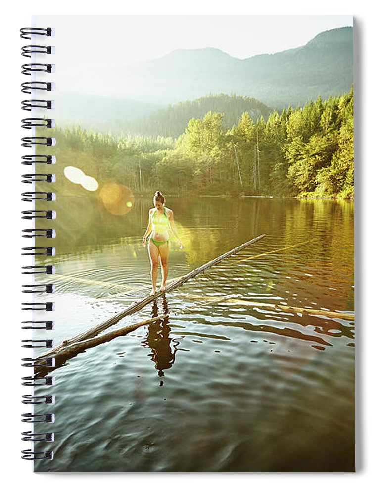 Pets Spiral Notebook featuring the photograph Woman Walking On Log In Alpine Lake by Thomas Barwick