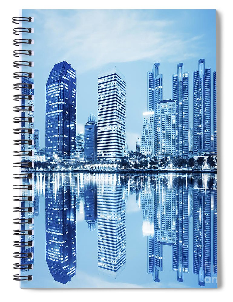 Architecture Spiral Notebook featuring the photograph Night Scenes Of City by Setsiri Silapasuwanchai