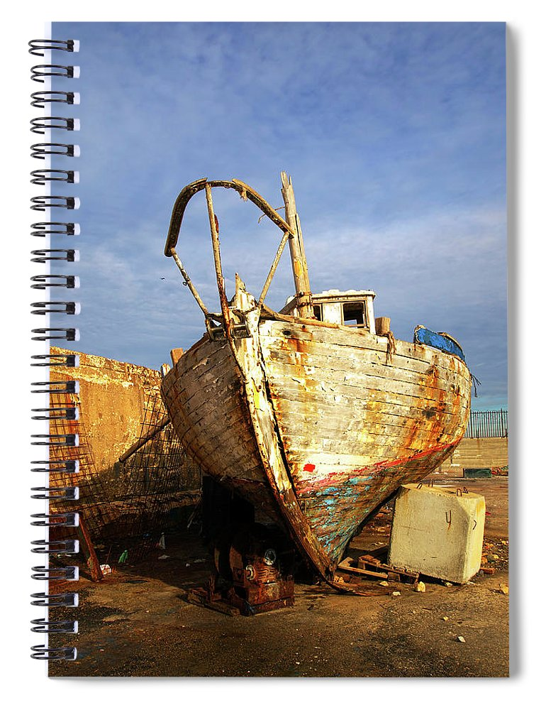 Old Spiral Notebook featuring the photograph Old Dilapidated Wooden Boat by Ofer Zilberstein