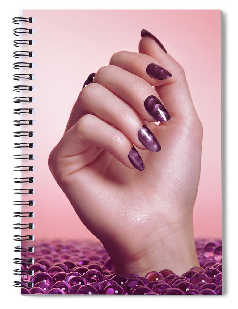 Manicure Spiral Notebook featuring the photograph Woman Hand With Purple Nail Polish by Oleksiy Maksymenko