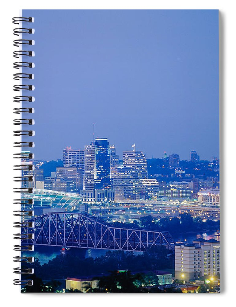 Photography Spiral Notebook featuring the photograph Buildings In A City Lit Up At Dusk by Panoramic Images