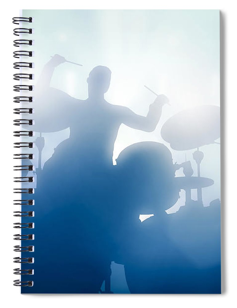Drums Spiral Notebook featuring the photograph Drummer playing on drums on music concert. Club lights by Michal Bednarek