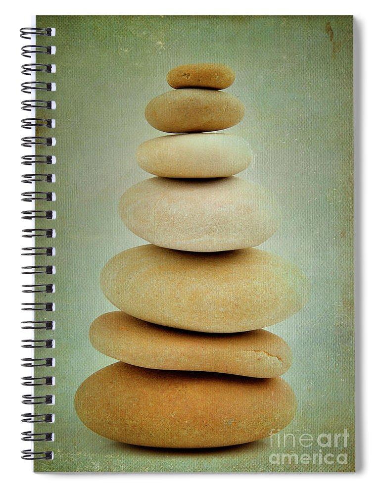 Balanced Spiral Notebook featuring the photograph Pile Of Stones by Bernard Jaubert