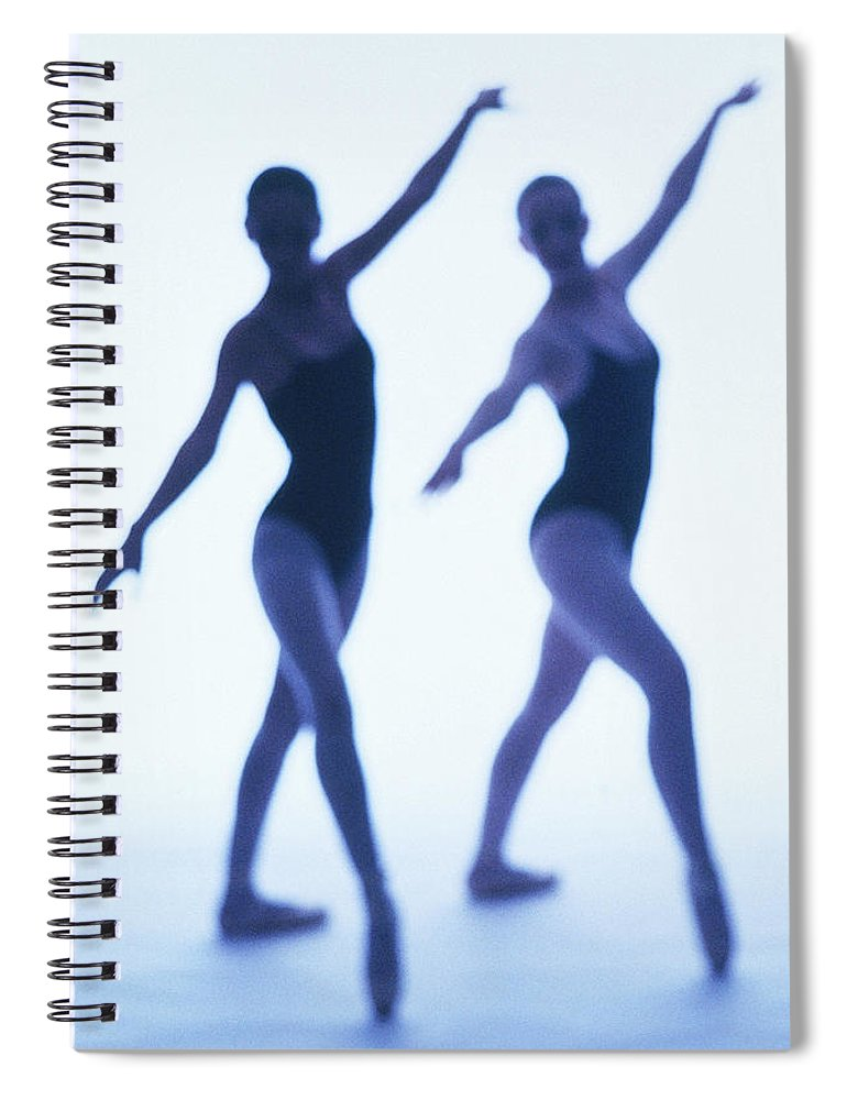 Ballet Dancer Spiral Notebook featuring the photograph A Silhouette Of Two Young Women by George Doyle