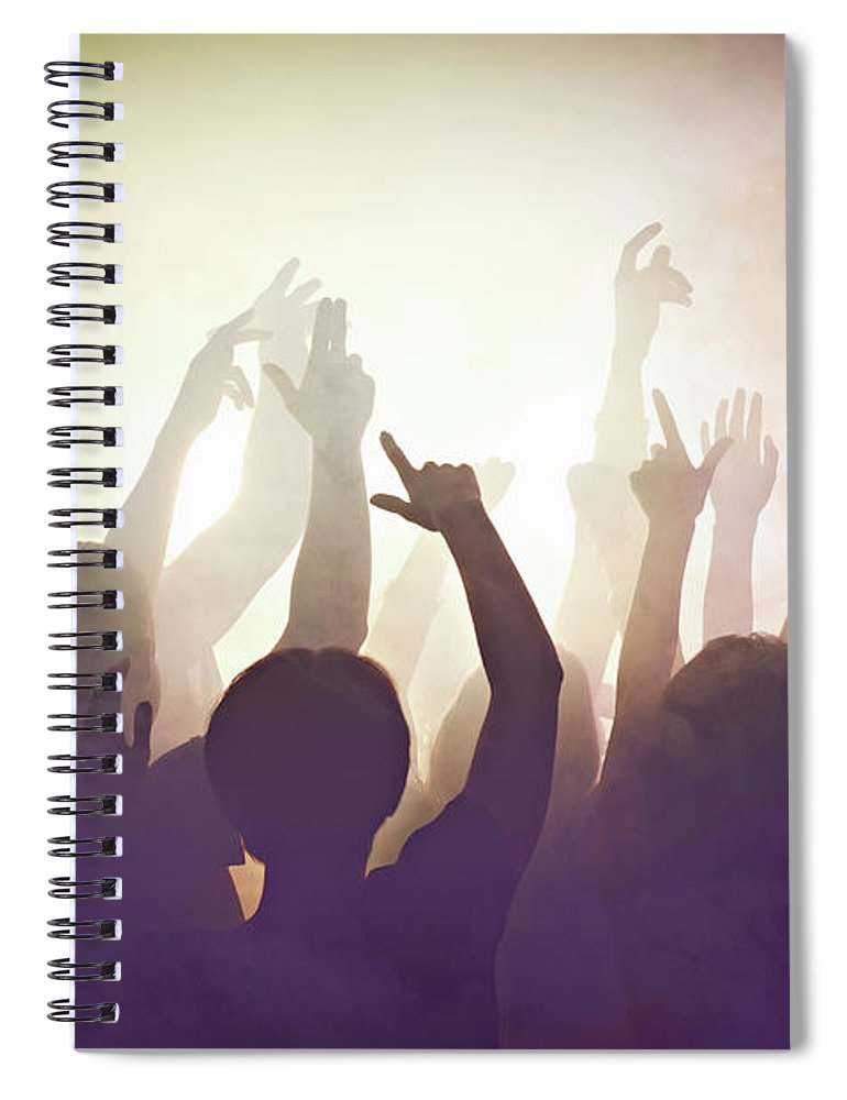 Young Men Spiral Notebook featuring the photograph Crowd Of People At Concert Waving Arms by Flashpop