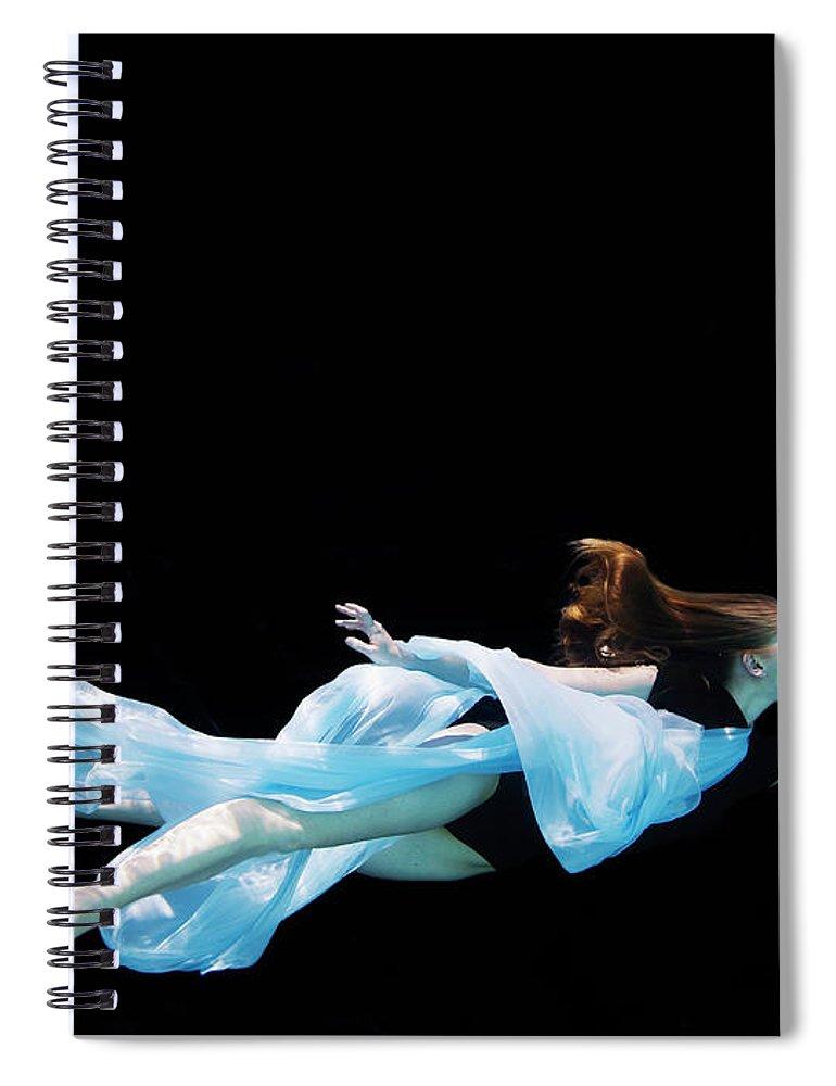 Ballet Dancer Spiral Notebook featuring the photograph Female Dancer Underwater Against Black by Thomas Barwick