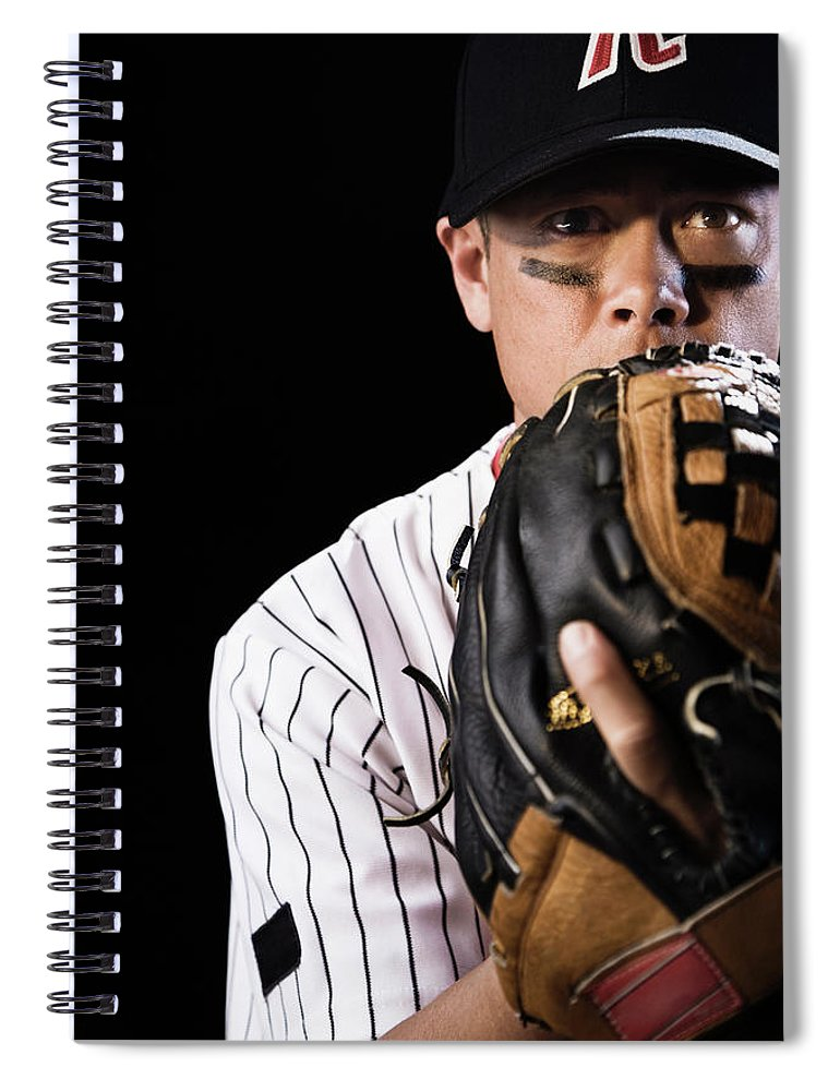 Baseball Cap Spiral Notebook featuring the photograph Mixed Race Baseball Player Pitching by Hill Street Studios
