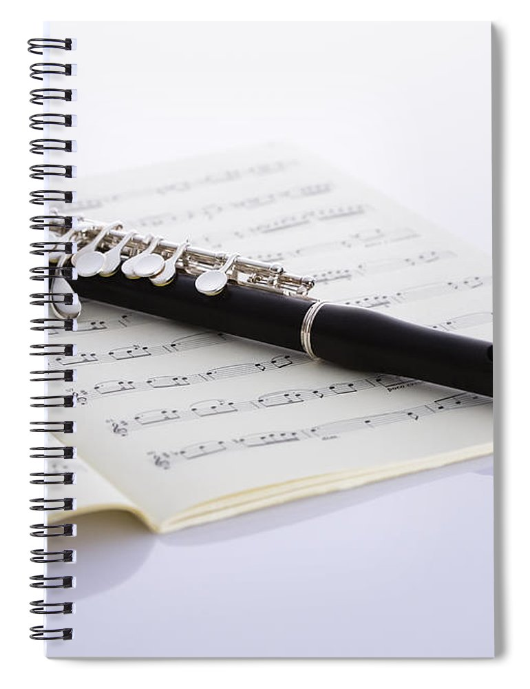 Sheet Music Spiral Notebook featuring the photograph Piccolo On A Score by Imagenavi