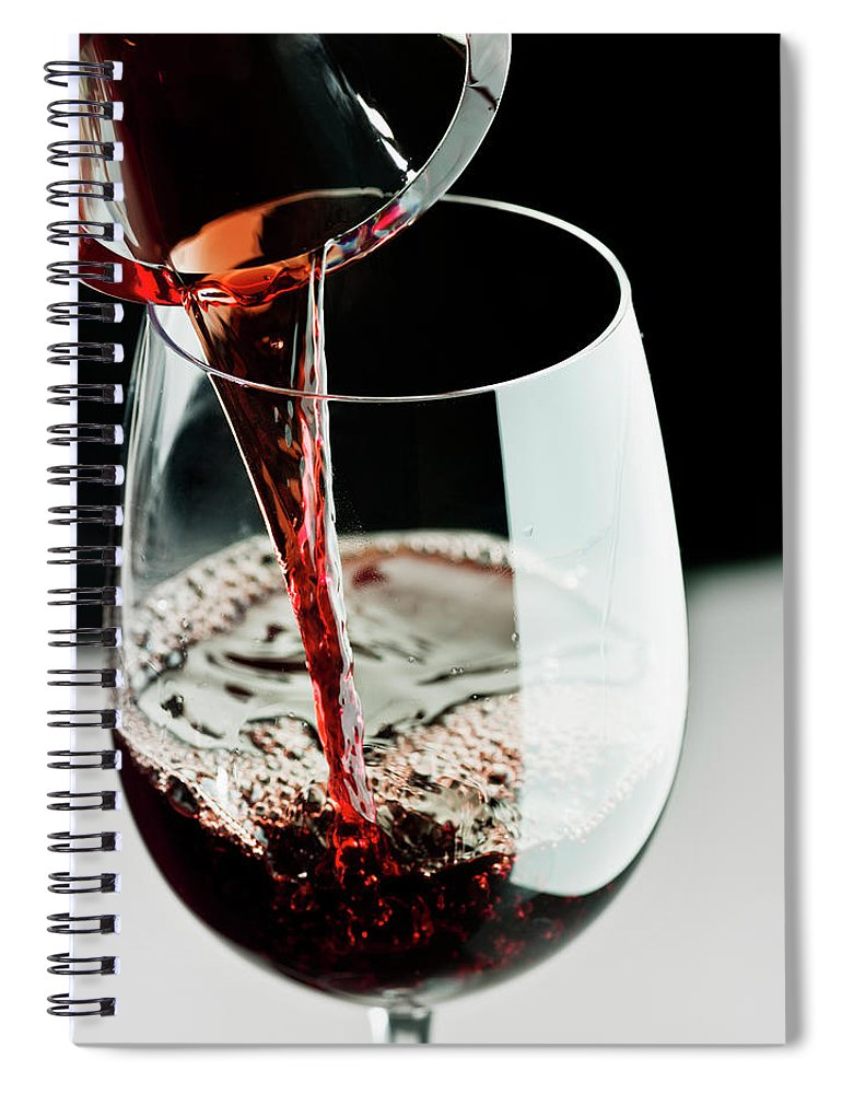 Alcohol Spiral Notebook featuring the photograph Red Wine Being Poured In A Glass by Juanmonino