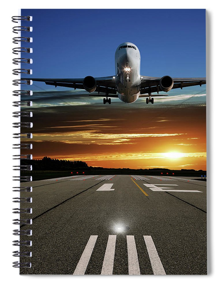 Orange Color Spiral Notebook featuring the photograph Xl Jet Airplane Landing At Sunset by Sharply done