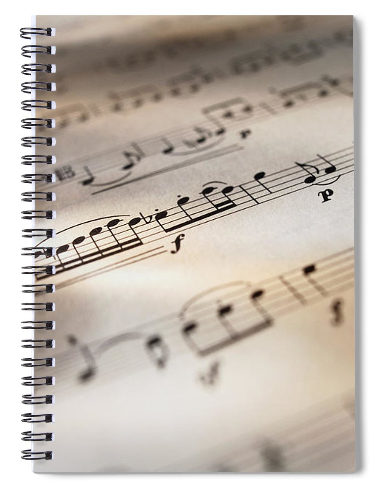 Sheet Music Spiral Notebook featuring the photograph Detail Of Sheet Music by Ryan Mcvay