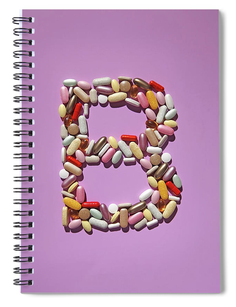 Vitamin Spiral Notebook featuring the photograph Multi-vitamin Pills And Capsules by Nicholas Eveleigh