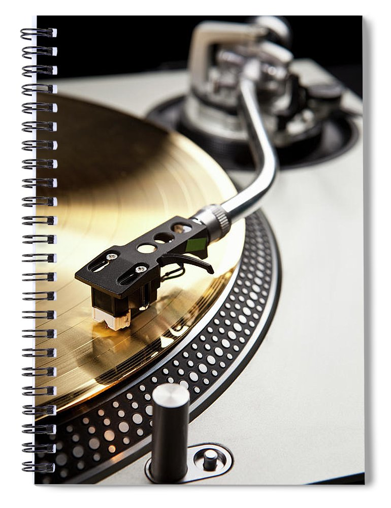 Music Spiral Notebook featuring the photograph A Gold Record On A Turntable by Caspar Benson
