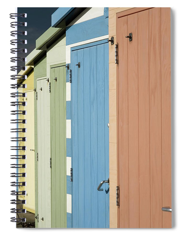 Beach Hut Spiral Notebook featuring the photograph A Row Of Beach Huts by Matthew Piper