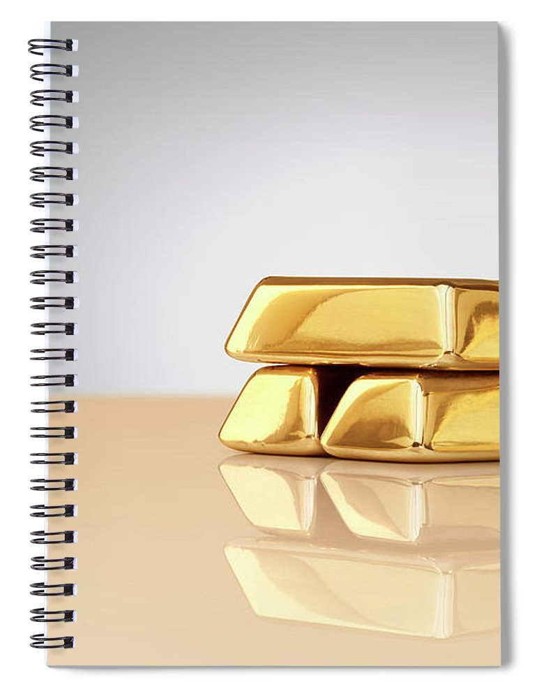 Four Objects Spiral Notebook featuring the photograph A Stack Of Four Gold Ingots by Anthony Bradshaw
