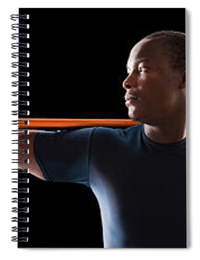 Young Men Spiral Notebook featuring the photograph African American Man Holding Track And by Mike Kemp