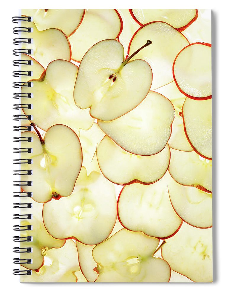 Large Group Of Objects Spiral Notebook featuring the photograph Apple Slices by Lauren Burke