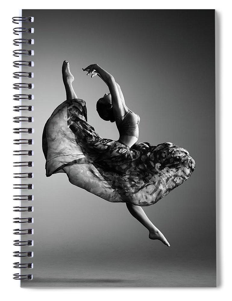 Ballerina Spiral Notebook featuring the photograph Ballerina Jumping by Johan Swanepoel