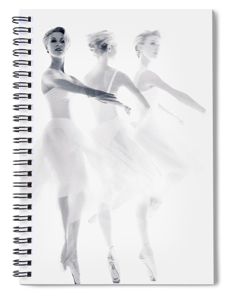 Ballet Dancer Spiral Notebook featuring the photograph Ballet Dancer Pirouetting Multiple by Getty Images