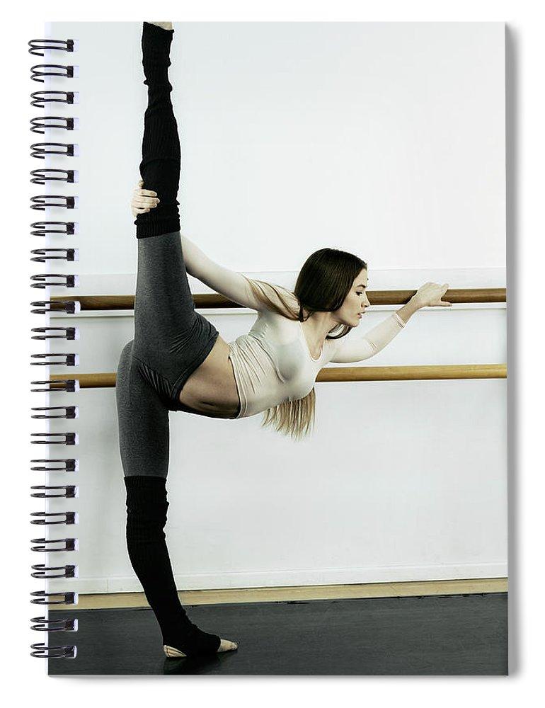 Ballet Dancer Spiral Notebook featuring the photograph Ballet Dancer Stretching In Dance by Patrik Giardino